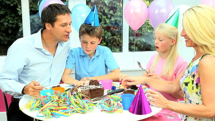 Attractive Caucasian Family Enjoying Birthday Cake