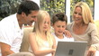 Young Caucasian Family with Laptop Computer