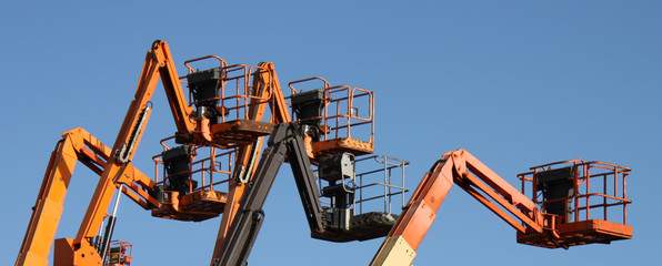 A Group of Mechanical Cherry Picker Lifts.