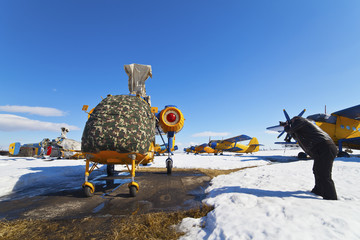helicopter stationed in winter on a snow covered field