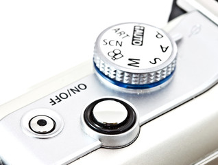modern digital camera shutter and program control wheel