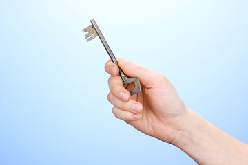 Key in hand on blue background