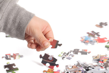 A child is playing his puzzle