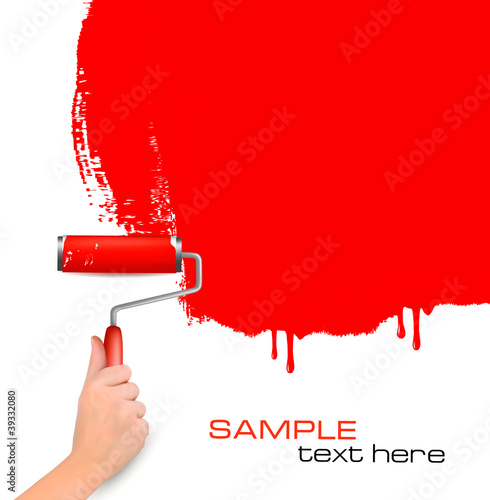 Hand with red roller painting the white wall