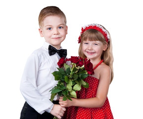 Girl and boy greeting with flowers isolated over white