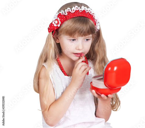 little girl trying makeup isolated on white background
