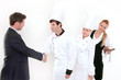 Handshake - restaurant manager and kitchen staff