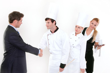 Handshake - restaurant manager and kitchen staff
