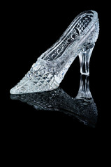 Woman crystal shoe on the black background