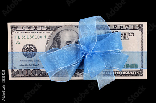 close up shot of dollar bill background with ribbon