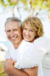 Mature couple smiling and embracing.