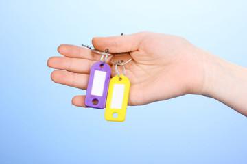 Keys in hand on blue background
