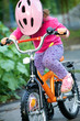girl in pink safety helmet