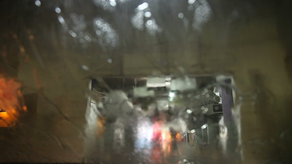 Shot from inside a car going through car wash machine