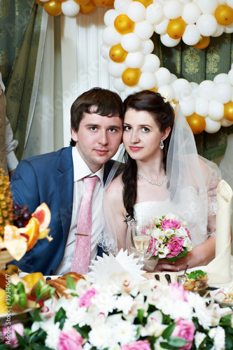 Happy bride and groom in wedding banquet
