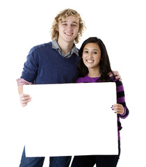 happy young couple holding blank sign