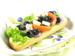 Close-up of sandwich with feta, olives, tomato and lettuce