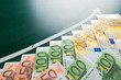 Euro banknotes and growing arrow
