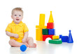 little child playing with building blocks