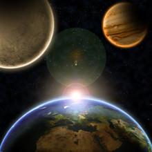 Planètes avec le lever du soleil dans l'espace