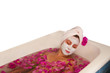 beautiful woman enjoying floral bath