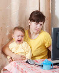 mother   working  with computer