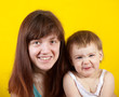 mother with  child  over yellow