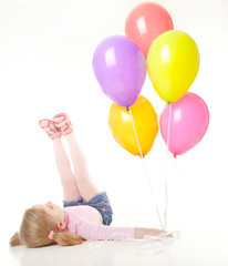 studio shot of pretty little girl with balloons