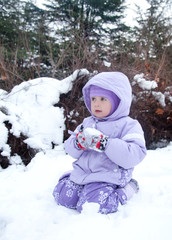 little girl in a winter park with