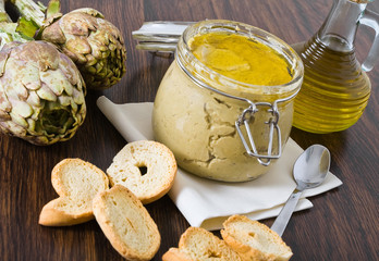 Artichoke pesto in glass jar.