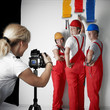 Photographer taking a picture of three painters at work