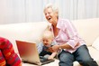 Grandmother with child browsing at internet