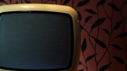 Retro grunge tv against wallpaper wall