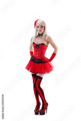 Sexy woman in red corset and mini skirt