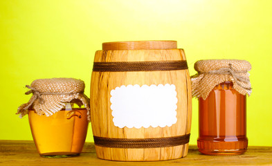 Sweet honey in jars and barrel