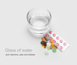 glass of water and vitamins, pills and tablets
