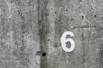 number six on vintage concrete wall background