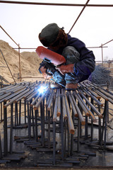 worker is welding work in a construction site