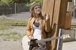 Mädchen mit Gitarre Nachdenklich am Rauchen