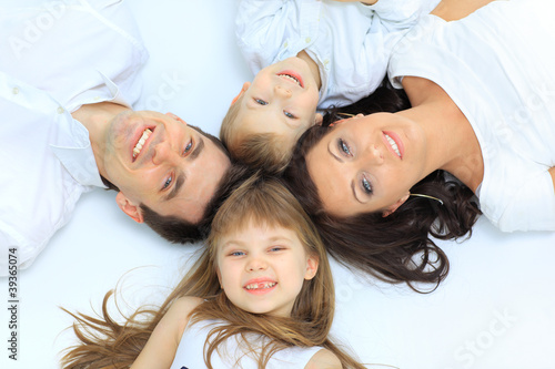Happy family, mother, father and daughter resting