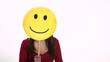 Happy young woman using smiling emoticon for emotions