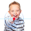 young boy pointing at touchscreen