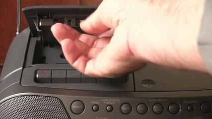 hand inserting cassette