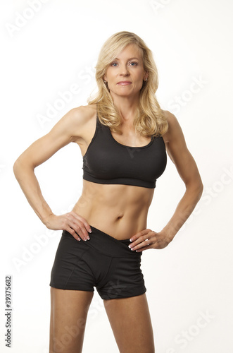 Healthy fit woman in workout exercise gear