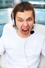 Closeup of angry screaming customer service executive