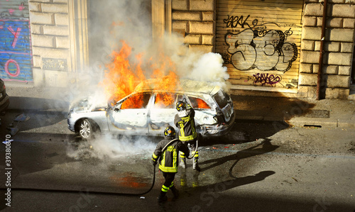 Riots - Fire fighters respond to a car fire