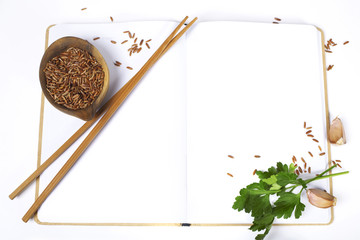 uncooked rice and chopsticks