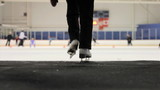 Girl Walks Onto The Ice At The Skating Rink