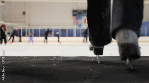 Woman Walks Onto The Ice At The Skating Rink