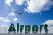 Aeroplane Clouds And Airport sign